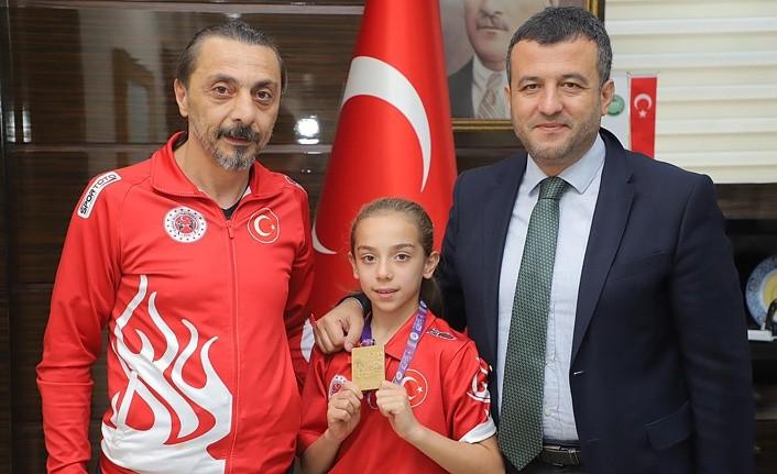 Dünya şampiyonu Başkan Doğan'ı ziyaret etti