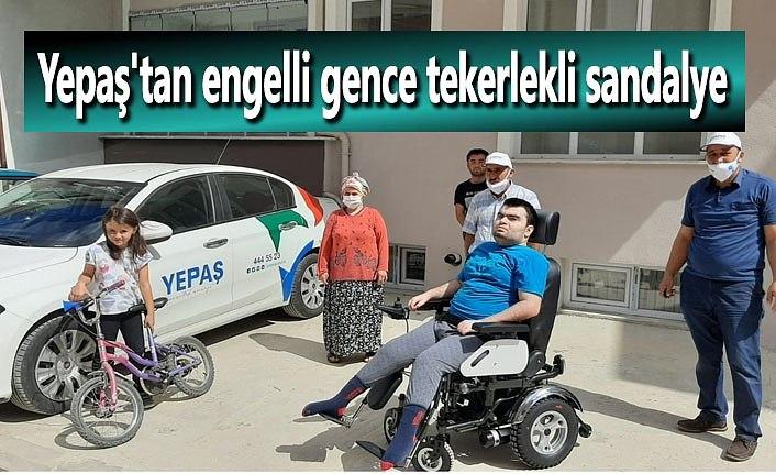 Yepaş'tan engelli gence tekerlekli sandalye