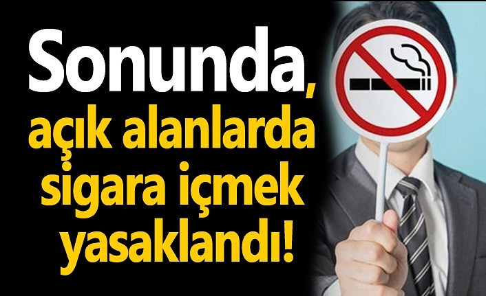 Maskesini indirip yolda sigara içene ceza!