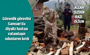 Güvenlik görevlisi Samsun'da diyaliz hastası vatandaşın odun kırmasına yardım etti